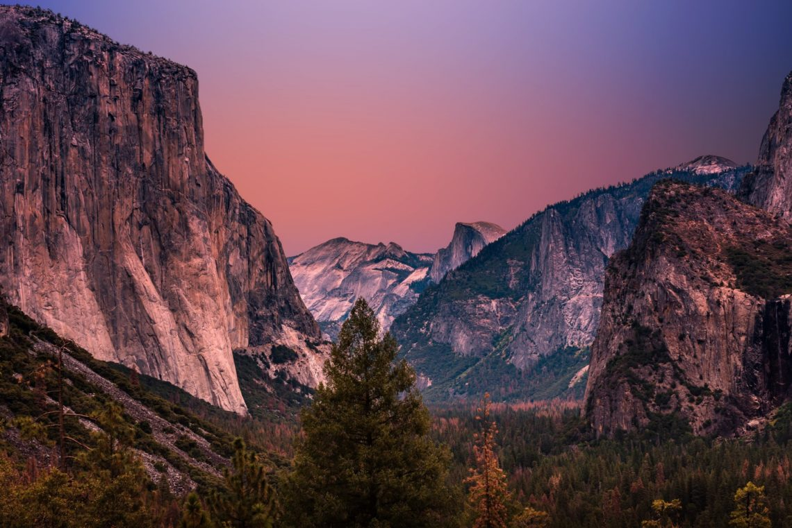 Colorful sunset over the Yosemite Valley travel down to Half Dome